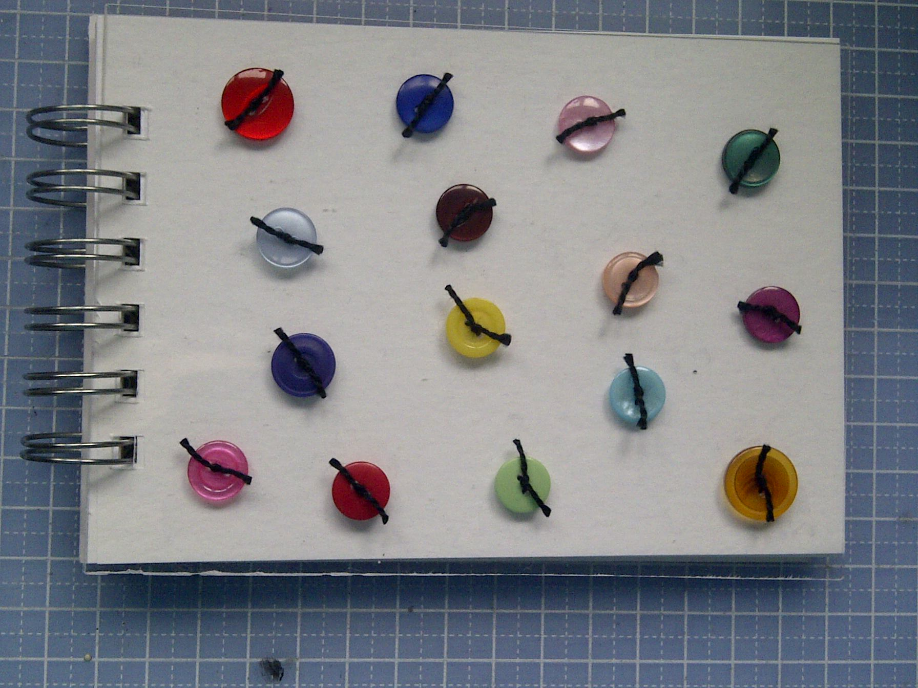 Perspex button notebook
